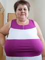 BBW in a striped dress demonstrating her - Picture 2