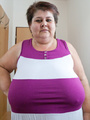 BBW in a striped dress demonstrating her - Picture 3