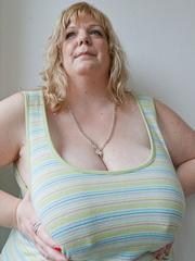 Mischievous blonde MILF in a striped dress wants a good - Picture 6