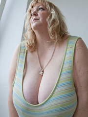 Slutty blonde bbw teasing you with her milky titties - Picture 3