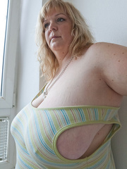 Slutty blonde bbw teasing you with her milky titties - Picture 8