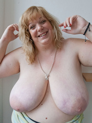 Slutty blonde bbw teasing you with her milky titties - Picture 12