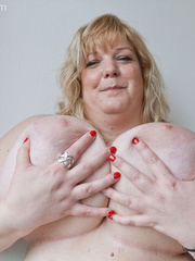 Slutty blonde bbw teasing you with her milky titties - Picture 15