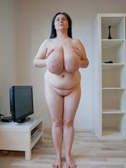 Seductive brunette mature presents her unbelievable huge - Picture 12