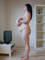 Seductive brunette mature presents her unbelievable huge - Picture 14