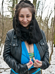 Busty brunette bitch baring her huge melons in the snow - Picture 6