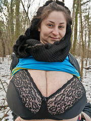 Busty brunette bitch baring her huge melons in the snow - Picture 7