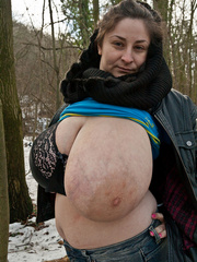 Busty brunette bitch baring her huge melons in the snow - Picture 10