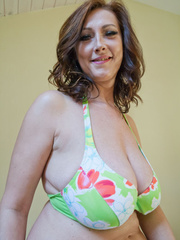 Hot brunette chick in floral bikini teasing you with her - Picture 2
