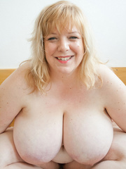 Slutty blonde fatty loves twisting her enormous juggs - Picture 1