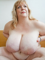 Slutty blonde fatty loves twisting her enormous juggs - Picture 2