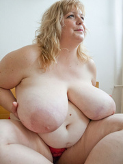 Slutty blonde fatty loves twisting her enormous juggs - Picture 4