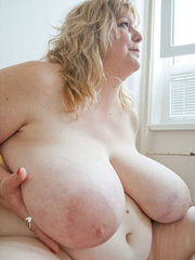 Slutty blonde fatty loves twisting her enormous juggs - Picture 5