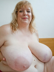 Slutty blonde fatty loves twisting her enormous juggs - Picture 6