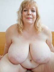 Slutty blonde fatty loves twisting her enormous juggs - Picture 9