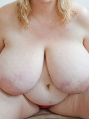 Slutty blonde fatty loves twisting her enormous juggs - Picture 10