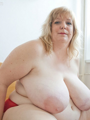 Slutty blonde fatty loves twisting her enormous juggs - Picture 11