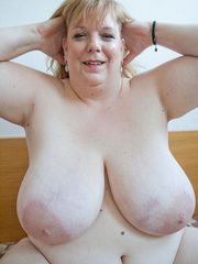 Slutty blonde fatty loves twisting her enormous juggs - Picture 12