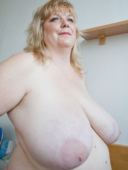 Slutty blonde fatty loves twisting her enormous juggs - Picture 14