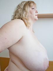 Slutty blonde fatty loves twisting her enormous juggs - Picture 15