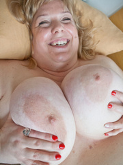 Blonde fatty playing with her giant titties laying on - Picture 6