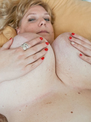Blonde fatty playing with her giant titties laying on - Picture 12