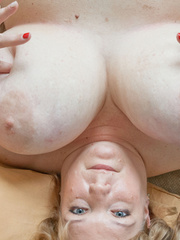 Blonde fatty playing with her giant titties laying on - Picture 13