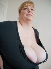 Blonde fatty in a red bra takes out her enormous boobs - Picture 4