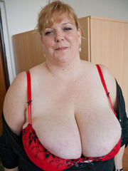 Blonde fatty in a red bra takes out her enormous boobs - Picture 7