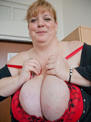 Blonde fatty in a red bra takes out her enormous boobs - Picture 9