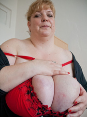 Blonde fatty in a red bra takes out her enormous boobs - Picture 11