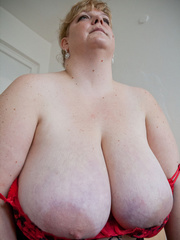 Blonde fatty in a red bra takes out her enormous boobs - Picture 12