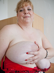 Blonde fatty in a red bra takes out her enormous boobs - Picture 14
