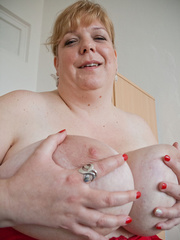 Blonde fatty in a red bra takes out her enormous boobs - Picture 15