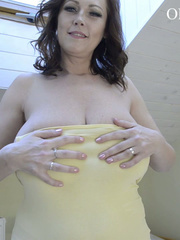 Busty brunette cutie pulls down her yellow dress to show - Picture 3