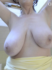 Busty brunette cutie pulls down her yellow dress to show - Picture 7