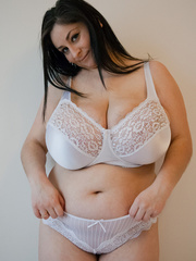 Dirty brunette bitch in a white lace lingerie with mega - Picture 3