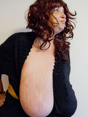 Brunette whore in a black dress exposing her saggy large - Picture 4