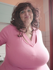 Curly brunette bbw in a pink pullover boasting with her - Picture 3