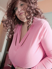Curly brunette bbw in a pink pullover boasting with her - Picture 5