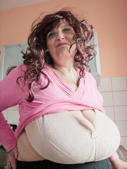Curly brunette bbw in a pink pullover boasting with her - Picture 8