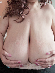 Curly brunette bbw in a pink pullover boasting with her - Picture 13