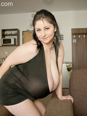 Brunette chick in a ponytail and a black club dress - Picture 3