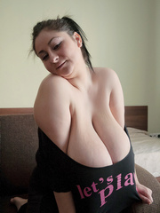 Sexy gipsy in a funny T-shirt biting one of her mega - Picture 2