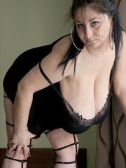 Horny brunette whore in fishnet and high heels looking - Picture 3