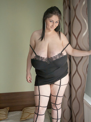 Horny brunette whore in fishnet and high heels looking - Picture 4