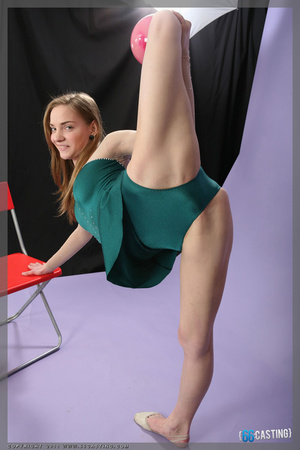 Cute blonde gymnast in a green dress posing with a ball - XXXonXXX - Pic 4