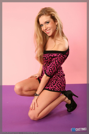 Slim blonde pinup in a bra shooting herself with a big camera through the mirror - XXXonXXX - Pic 12