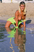 Hot blonde beach babe exposing her lusciously formed body at the beach.