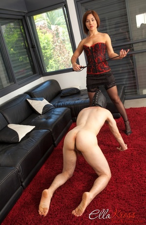Bodacious red mistress in a corset and stockings with a whip - XXXonXXX - Pic 3